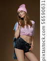 cute hipster girl in jeans shorts, a pink hat and stylish glasses 56590631