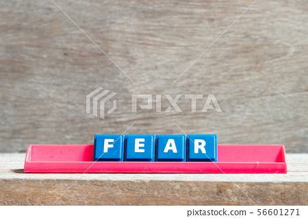 Tile letter on red rack in word fear 56601271