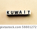 Letter block in word kuwait on wood background 56601272