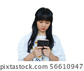 Cute Asian Girl Using Mobile Phone with Serious 56610947
