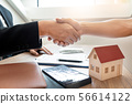 Customer and broker shake hands agreeing to buy 56614122