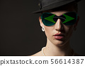 Portrait of woman with Brazil flag sunglasses 56614387