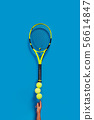 Sport. Tennis racket and balls balancing on a finger 56614847