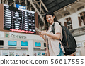 woman traveller use smartphone front of ticket 56617555