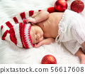 Asian newborn baby wearing a knitted Christmas elf 56617608