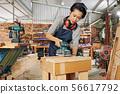 Carpenter polishing wooden surface 56617792