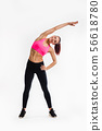Full length portrait of a healthy young fitness woman doing exercises over white background 56618780