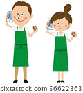 A man and a woman in a pop green apron make a guts pose while talking 56622363