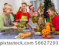 Happy family is celebrating New Year together and preparing 56627293