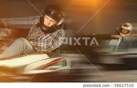 Man driving go-kart car 56627310