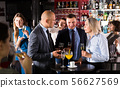 Colleagues discussing at corporate party 56627569