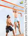 Adult men are jumping with ball in time play in volleyball 56627574