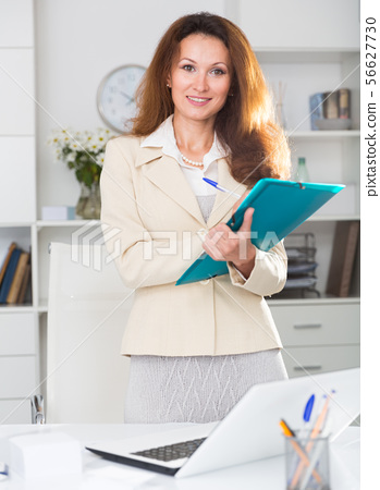 Woman is talking with partner before signing documents 56627730