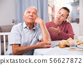 Upset senior man and daughter quarrelling at home interior 56627872