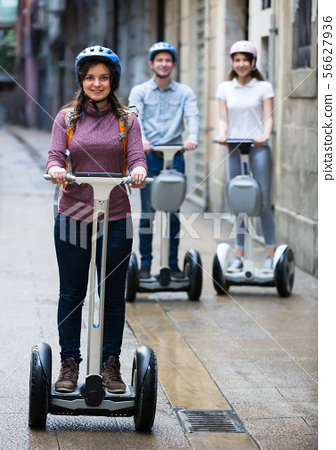 Happy friends posing on segways in vacation 56627936