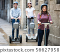 Young friends posing on segways in vacation 56627958
