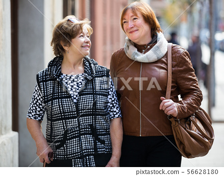 Mature women having a walk 56628180