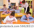 Portrait of ordinary schoolgirl and children 56628313