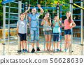 Five kids posing at the playground together 56628639