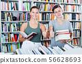 Teenagers buying new books 56628693