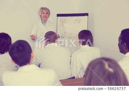Female giving presentation for medics 56628737