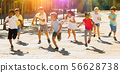 Children running in race and laughing outdoors at sunny day 56628738