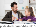 Father helping daughter with homework 56628815