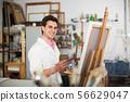 Artist painting on canvas 56629047