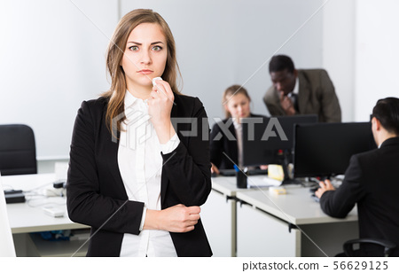 Unhappy girl in office 56629125