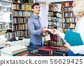 Man taking book from seller 56629425