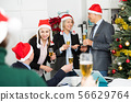 Colleagues celebrating Christmas in office 56629764