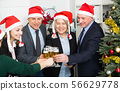 Happy business group people in santa hat at Xmas corporate party 56629778