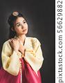 Korean woman in traditional korean dress (Hanbok). 56629882