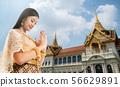 Thai Woman at Temple of the Emerald Buddha Bangkok 56629891