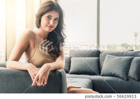 Beautiful business woman sitting on sofa in office 56629913