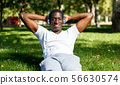 Young male training exercises for legs and other at park outdoor 56630574