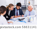 Employees are writing financial reports 56631141