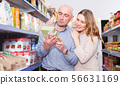 Couple customers looking groats in grocery food shop 56631169