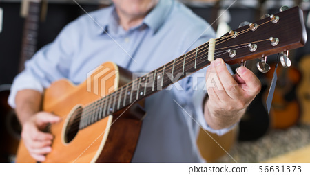 Picture of modern wooden acoustic guitar 56631373
