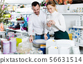 Couple choosing new crockery in dinnerware store 56631514