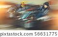 Man and women competing on racing cars 56631775