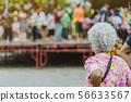 Back view of standing elder female 56633567