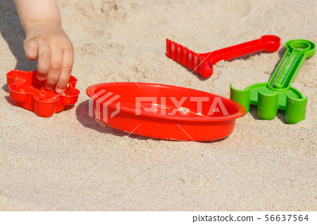 Hand of children with toys for playing on sand 56637564