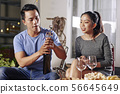 Young Asian man opening wine 56645649