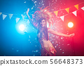 Carnival, belly dance and holiday concept - Beautiful female samba dancer wearing gold costume and 56648373
