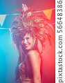Holidays, party, dance and nightlife concept - Beautiful woman dressed for carnival night 56648386