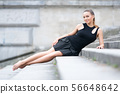 Beautiful woman with shapely long legs 56648642