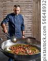 Preparetion dish of spaghetti with clams in a restaurant kitchen 56648932