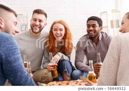 Friends talking, eating pizza and drinking beer 56649322
