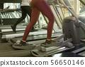 People running on treadmill 56650146